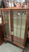 A mahogany display cabinet (missing shelves).