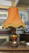 An oriental style table lamp with shade.