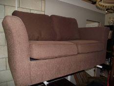 A brown fabric 2 seat sofa.