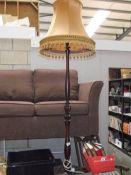 An Edwardian dark wood standard lamp.