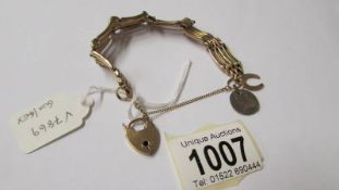 A 9ct gold bracelet with padlock, 15.8 grams (re-entered due to non paying bidder).