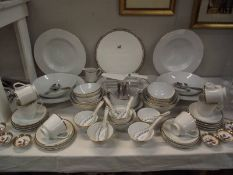A quantity of white dinner ware