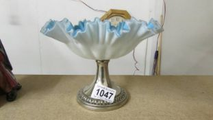 A frilled frosted blue glass dish on plated stand marked WMF EPNS.