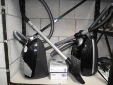 2 Bosch vacuum cleaners.