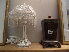 A decorative lamp and lidded box