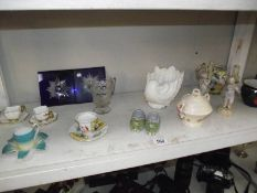 A mixed lot including cherub figures some a/f. Tea cups and saucers etc.