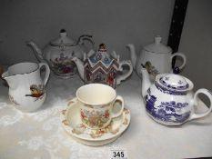 A collection of teapots including Doulton, Bunnikins, nursery ware etc.
