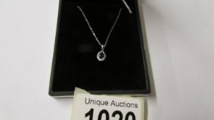 An 18ct white gold sapphire and diamond pendant necklace of 30 points.