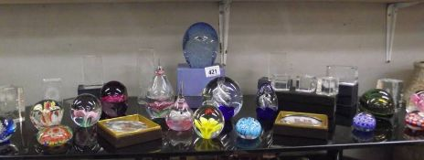 A good lot of glass paperweights etc.
