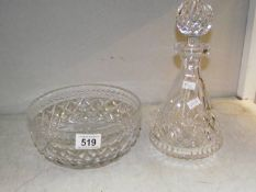 A cut glass decanter and a cut glass bowl.