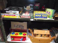 2 shelves of old games including wooden Noah's ark.