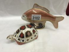 A Royal Crown Derby fish with gold stopper and a Royal Crown Derby tortoise with no stopper.
