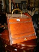 A good Edwardian mahogany coal box complete with liner and shovel.