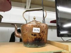 A Victorian copper kettle.