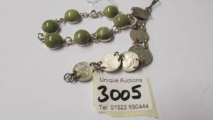 A silver bracelet set probably epidote stones with what looks like a Dublin 1967 hall mark together