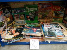 One shelf of old comics,
