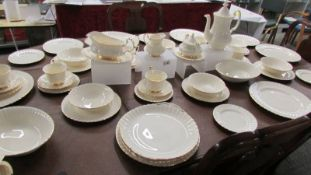 Approximately 54 piece of Royal Albert affinity gold pattern tea and dinner ware.