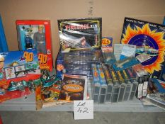 A large shelf of Fireball and Joe 90 toys and videos etc.