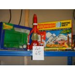 A shelf of Thunderbird items including 3D painting set etc.
