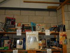 Three shelves of JFK hardback books. paperback books and other memorabilia etc.