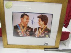 A framed and glazed Russian cosmonaut photo with signature.