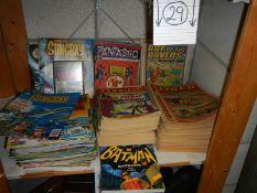 A shelf of old comics including Tiger, Terrific, Batman, Sting Ray etc.