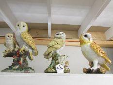 3 large owl figures.