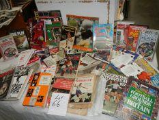 A large mixed lot of football memorabilia, books, magazines etc.