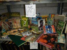 A shelf of sports related memorabilia including Archery, boxing,