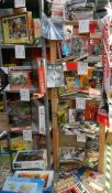 Five shelves of football magazines, hardback and paperback books etc.