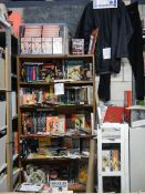 Nine shelves of Bruce Lee related items, Kung Fu books. posters, videos etc.