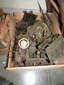 A box of clock movements.