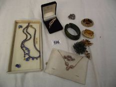 A mixed lot of vintage costume jewellery including necklaces, brooches etc.