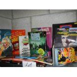 One shelf of assorted Doctor Who books and memorabilia etc.