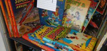A shelf of assorted annuals including Beano, Dandy, Tiger, Super Car etc.