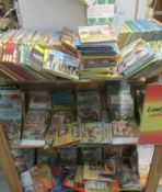 Three shelves of assorted Lady bird books with a 1986 catalogue.