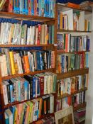 12 shelves of assorted books including some relating to India.