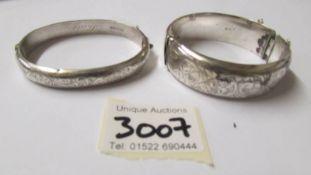 2 silver bangles.