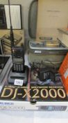 A boxed Alinco DJ-X 2000 multi band receiver with mains lead and fast charger, in working order.