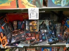 On shelf on Magazines, books, videos, CD's etc., relating to The X Files.
