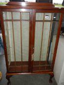 An Edwardian display cabinet (no shelves).