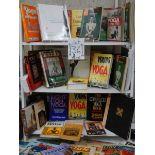 Three shelves of interesting books relating to Yoga.