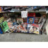 One shelf of James Bond 007 pictures, magazines, CD's etc.