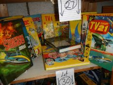 A shelf of assorted annuals including TV 21, TV Comic, Sting Ray etc.