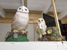 A large owl and an owl planter.