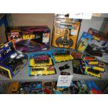 A shelf of assorted Batman toys including Batjet etc.