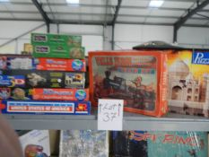 A top shelf of jigsaw puzzles including 3D.