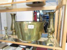 A brass jam pan, a pair of brass vases and a pair of brass candlesticks.