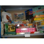 A large shelf of puzzles and games.