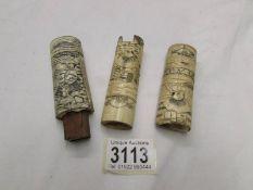 3 oriental carved bone handles.
